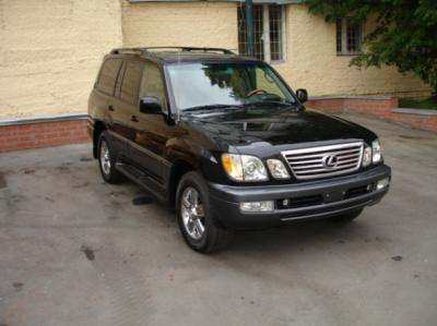 Лексус LX-470, Limited Edition (выпущено всего 400 автомобилей) черный, салон - серая кожа, отделка черным деревом,навигация, ка